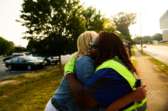 Felissa Lattimore hugs crossing guard coordinator Amber Caine at the intersection of East North Street and Prescott Street Monday, June 3, 2019.