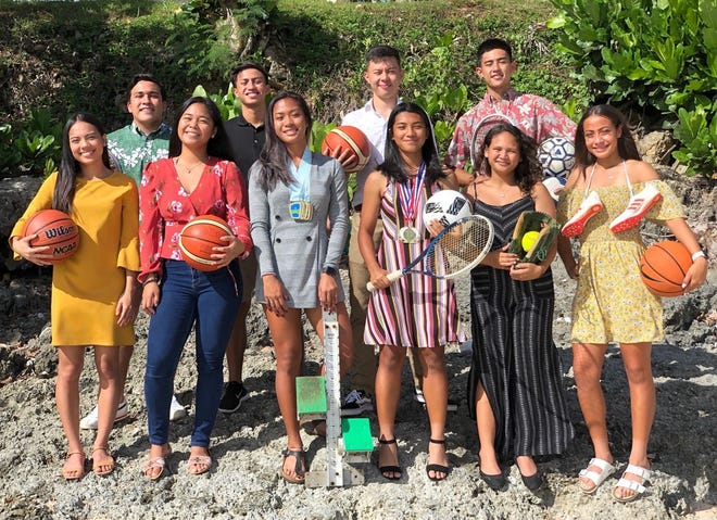 In this file photo from 2019, the Shieh Su ing Scholar Athlete finalists gather for a picture. They are,  front row from left, Isla Quinata (St. Paul), Danica Cabrera (Okkodo), Richelle Tugade (JFK), Alyssa Dumlao (Tiyan), Nyah-Kimani Chamberlain (JFK), and Alexia Brown (Guam High). Second row from left, Matias Calvo (FD), Brian Anderson (FD), Chris Morikami (JFK), Mason Caldwell (Harvest Christian Academy), Not pictured: Jaeryong Noh (Harvest Christian Academy)