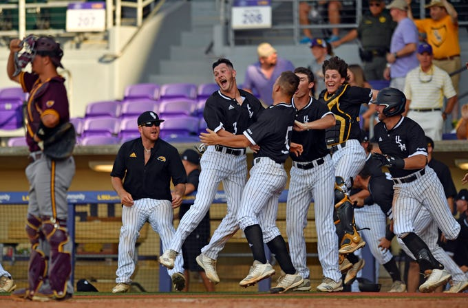 Southern Mississippi celebrates after defeating Arizona State on a two-RBI single in the bottom of the ninth inning in an NCAA college baseball tournament regional game Sunday, June 2, 2019, in Baton Rouge, La. (Hilary Scheinuk/The Advocate via AP)