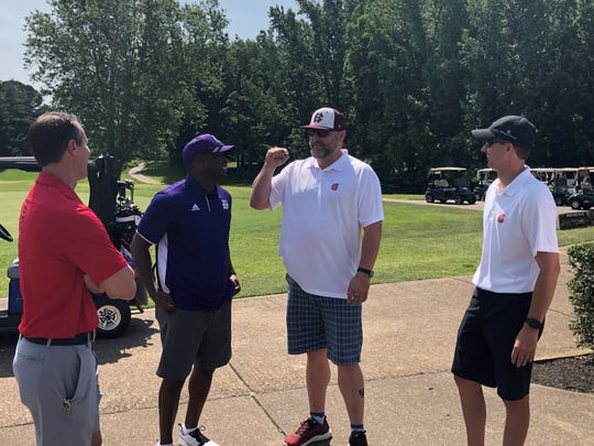 Kentucky Wesleyan football coach and former University of Kentucky receiver Craig Yeast, second from left, visits with Greg Risch, Shane Ball and Erick Dalton before the start of the Sam Ball Living Legend Golf Scramble Monday at Henderson Country Club. The event benefits the Salvation Army of Henderson County.