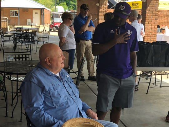 A pair of University of Kentucky football greats visit before the start of the Sam Ball Living Legend Golf Scramble which benefits the Salvation Army of Henderson County. Ball, left, visits with former UK receiver Craig Yeast, who is now the head coach at Kentucky Wesleyan College.