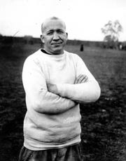 A 1925 photo of Notre Dame football coach Knute Rockne at an unknown location.