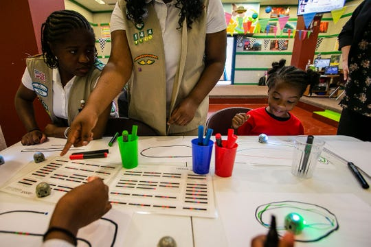 Alissa Dumas, 16, left, looks out at the table during an activity next to Zion Wilson, 12, and Cecil Khadijah Diakite Kariessy, at the Girls Scouts Math and Science Center at Camp Dellwood, Wednesday, May 29, 2019, Indianapolis.