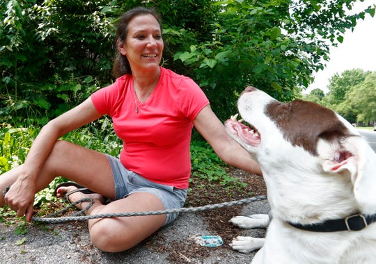 Johnna Magers sits with one of her dogs, Friday, May 31, 2019.  She suffers from chronic pain and worries about pain medication guidelines that take medication from those who really need it.
