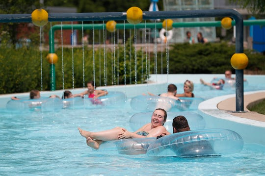 Adults and kids enjoy the Lazy River at The Waterpark in Carmel.