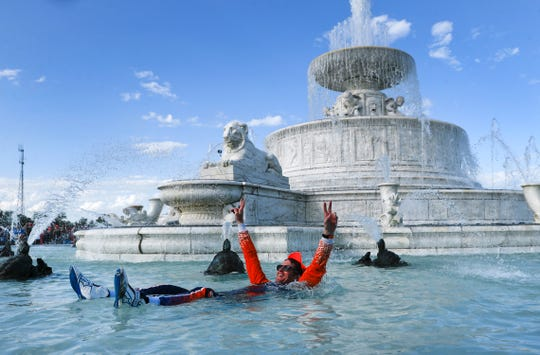 Scott Dixon, of New Zealand, celebrates by swimming in the James Scott Memorial Fountain after winning the second race of the IndyCar Detroit Grand Prix auto racing doubleheader in Detroit, Sunday, June 2, 2019.