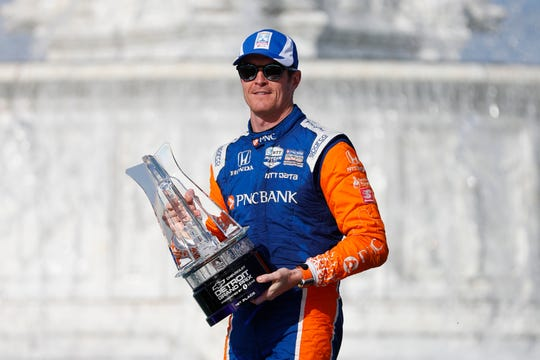 Scott Dixon, of New Zealand, celebrates after winning the second race of the IndyCar Detroit Grand Prix auto racing doubleheader in Detroit, Sunday, June 2, 2019.