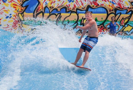Alex Van Bivver works the waves on the FlowRider at The Waterpark at the Monon Center on Monday, June 3, 2019.