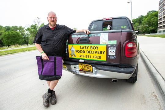 Jermaine Ramsey, owner of Lazy Boy Food Delivery, stands for a photo, Monday, June 3, 2019, outside Mayflower Residence Hall in Iowa City.
