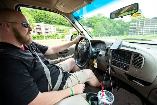 Jermaine Ramsey, owner of Lazy Boy Food Delivery, drives his truck, Monday, June 3, 2019, outside Mayflower Residence Hall in Iowa City.