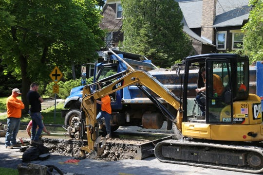 A crew works to repair a water main.
