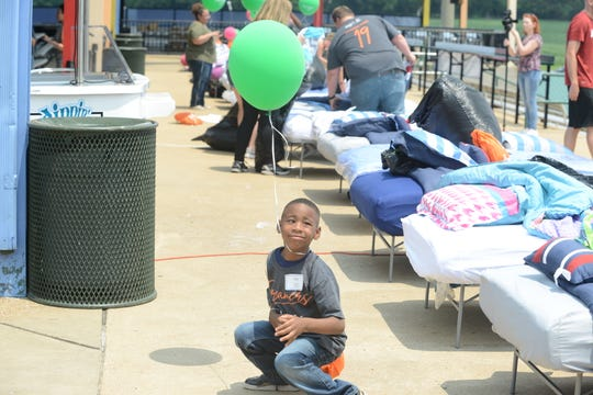 Damon Hauer gets caught in one of the balloons at the Ashley Home Stores Hope to Dream program at the Ballpark in Jackson on June 1 in Jackson, Tenn