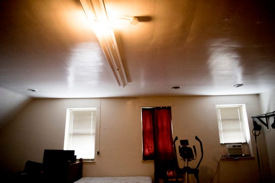 A ceiling light turns on inside the sleeping quarters of Fire Station No. 11 when a call for service comes in.