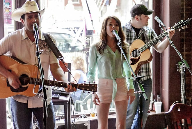 Kari Holmes, center, along with William Shadrick and Pete Johnson sing at a 2016 Rock the Block event in Howell.  The 2019 installment of the annual music and food festival kicks off Wednesday.
