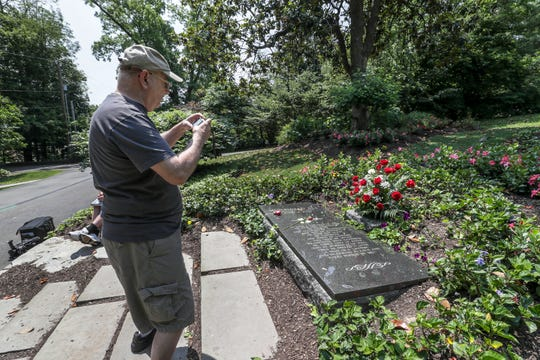 Richard Augustyniak takes photos at the grave of Muhammad Ali at Cave Hill Cemetery on Monday, the third anniversary of his death.