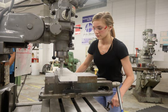 Alisa Beatty hones her skills in the metal shop at Southern High School in Louisville.