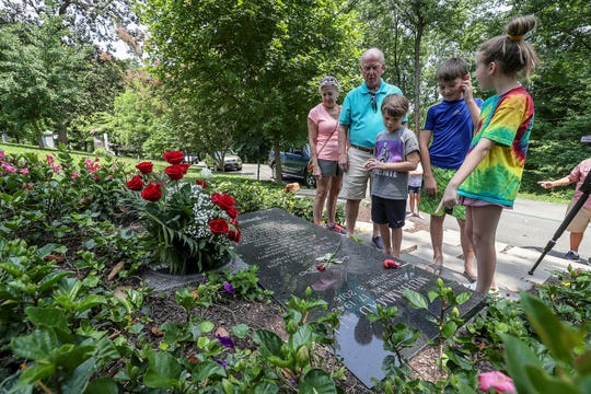 Chuck and Christy Kavanaugh brought their grandchildren, Garrett Howard, Gavin Howard and Harper Kavanaugh to visit the grave of Muhammad Ali at Cave Hill Cemetery on the third anniversary of his death. June 3, 2019