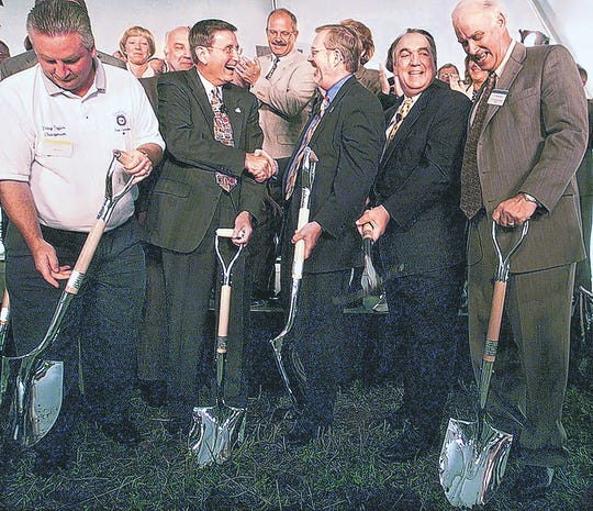 Front row, from left, Doug Taylor of United Auto Workers 602, then-Delta Township supervisor Joe Drolett, then-Lansing Mayor David Hollister, then-Gov. John Engler and Jerry Elson of GM celebrate at the June 2000 groundbreaking for the General Motors plant in Delta Township.