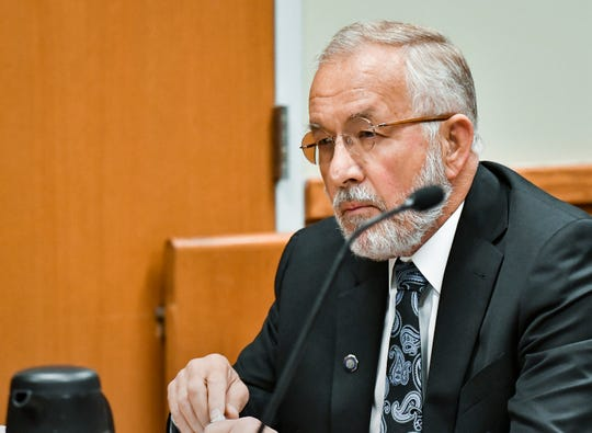 William Strampel, the former dean at the College of Osteopathic Medicine at Michigan State University looks on as  Dr. Jessica Neuroth testifies last year, June 5, 2018, during a preliminary hearing in East Lansing 54B District Court.