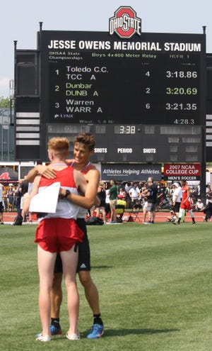 Blake Lucius (facing camera) and Caleb Brown embrace after accounting for three individual state championships and collaborating on a title-winning 4x800 relay team, leading the Shelby Whippets to the Division II boys track and field crown.