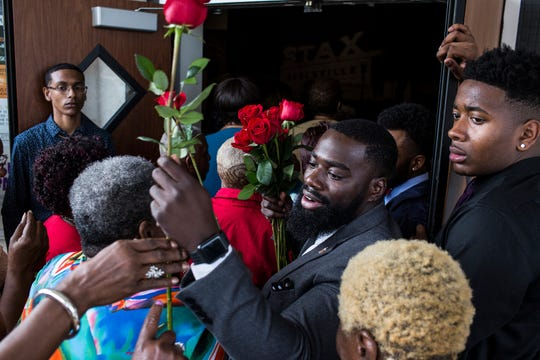 DeMarcus Little hands out roses as people arrive for Mayor Lee Harris' Senior Prom held at the Stax Museum of American Soul Music on Monday, June 03, 2019. Shelby County invited anyone over the age of 60 to experience the free prom and provided food, drinks and prizes.