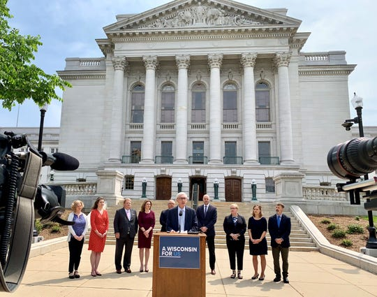 Gov. Tony Evers meets with reporters Monday at the state Capitol to announce a partnership between the Department of Health Services and the Office of the Commissioner of Insurance aimed at boosting enrollment in the health care marketplace and in BadgerCare.