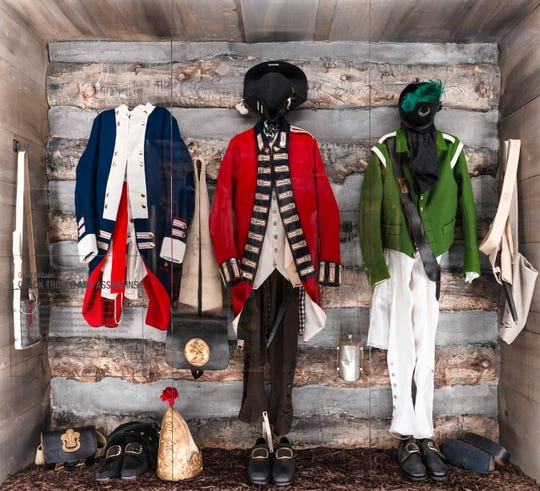 "Uniforms of Revolutionary War soldiers are on display at ""Hamilton: The Exhibition."""