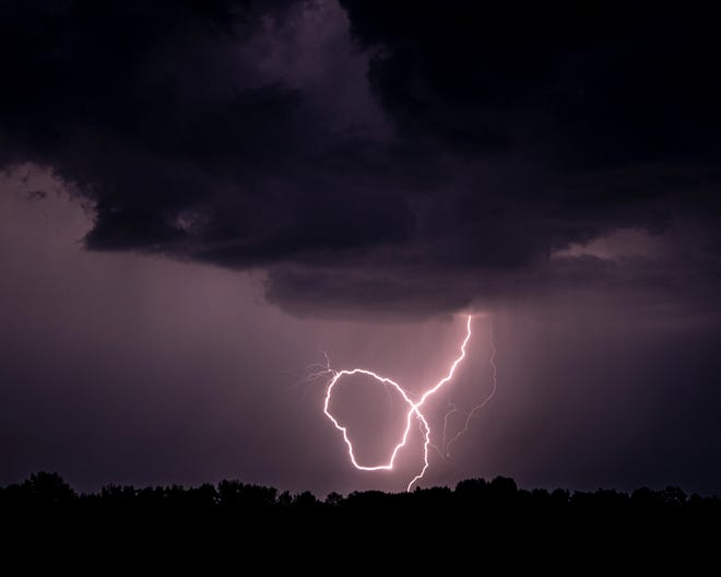 Jerry Zimmer shot this photo of a lightning strike in the shape of Wisconsin in western Wisconsin on Friday.