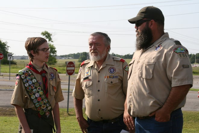 As part of Matthew Snyder's Eagle Scout project for Boy Scout Troop 156, (from left) Matthew Snyder, his father Roger Snyder and Assistant Scoutmaster Bobby Horn attended a dedication ceremony in front of the Fraternal Order of the Eagles Lodge 3183 in Midway in Saturday. Matthew Synder dedicates 200 hours into revitalizing the landscaping in front of the lodge around the flag poles.