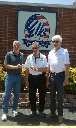 The Corvettes of the Ozarks car club recently presented a donation to the Mountain Home Elks Club #1714 for their upcoming Veterans Golf Tournament. Pictured are (from left) Elks Club member Dave Allen, president of the Corvette club; Clint Gunderson, Elks Veterans Tournament committee member; and Tony Dillon, Corvette club member.