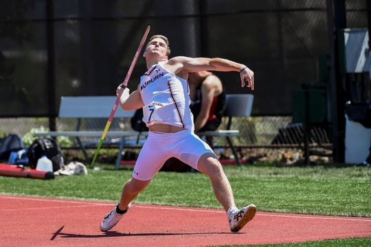 Auburn track and field athlete Cade Antonucci throws the javelin during a meet.
