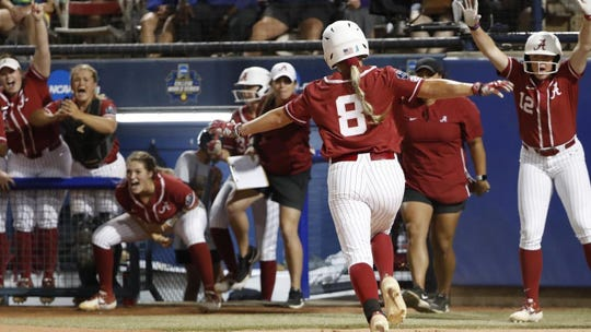 Alabama softball player KB Sides (No. 8) celebrates scoring a run against Arizona on Saturday, June 1, 2019, in the Women's College World Series in Oklahoma City.