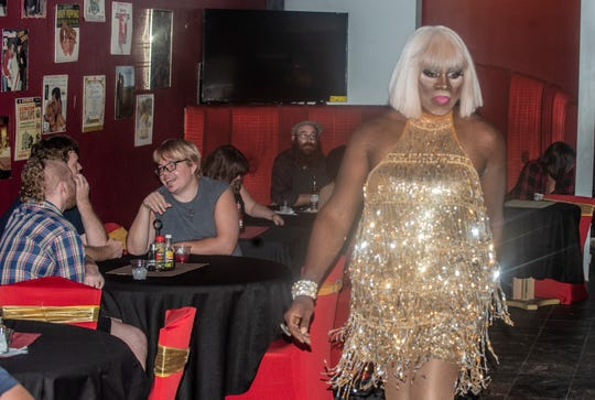 Victoria A. Jewelle walks through A Touch Of Soul Cafe in drag during LGBTQ Friday on May 31, 2019, a fundraiser for The Starlite.
