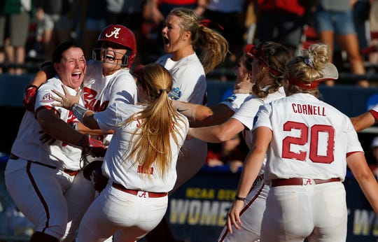 Alabama celebrates the winning run over Oklahoma in the eighth inning during an NCAA college softball game in the Women's College World Series in Oklahoma City, Sunday, June 2, 2019. (Sarah Phipps/The Oklahoman via AP)