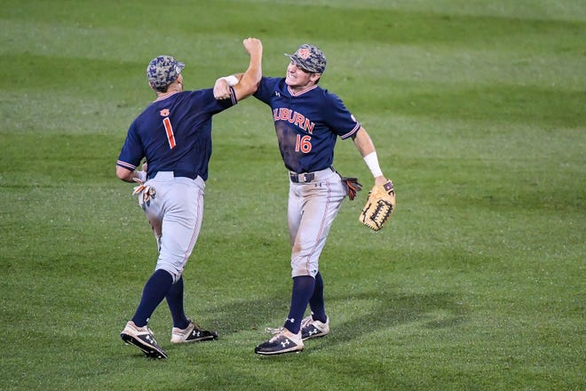 Auburn's Kason Howell (16) and Judd Ward (1) celebrate after a play against Georgia Tech during an NCAA Regional on Sunday, June 2, 2019, in Atlanta, Ga.
