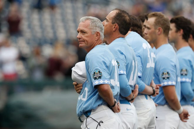 North Carolina head coach Mike Fox observes the national anthem prior to a game against Oregon State in the College World Series at TD Ameritrade Park on June 20, 2018, in Omaha, Neb.