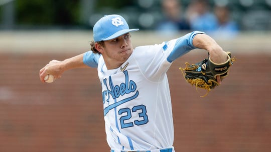 North Carolina's Tyler Baum (23) pitches during an NCAA college baseball game, Saturday, April 20, 2019, in Chapel Hill, N.C.