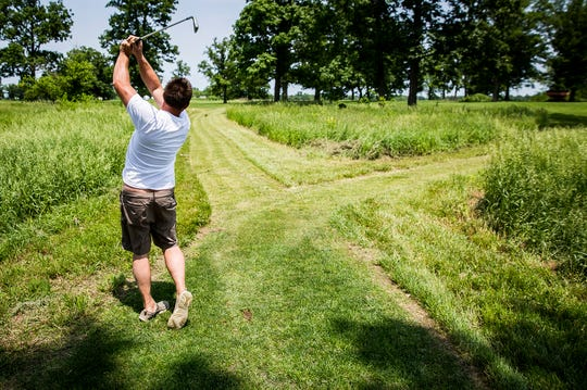 Jason Mauck plays golf at his home course on his farm in Gaston.