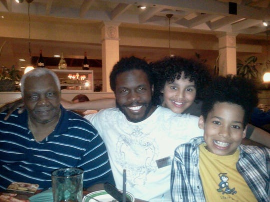 Nashville tech guru Marcus Whitney, second from left, with his dad, Marcus Whitney, left, and his sons Tristan and Ciaran in 2011 at an Olive Garden to celebrate Ciaran's birthday.