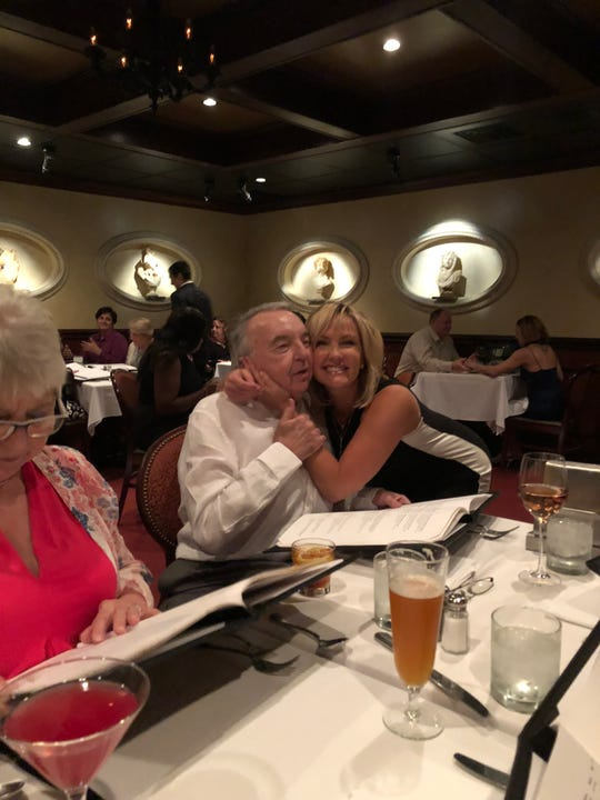 Channel 4 news anchor Tracy Kornet hugs her dad, James David Wing, in 2018 at Kornet's birthday dinner in Tampa, Fla.