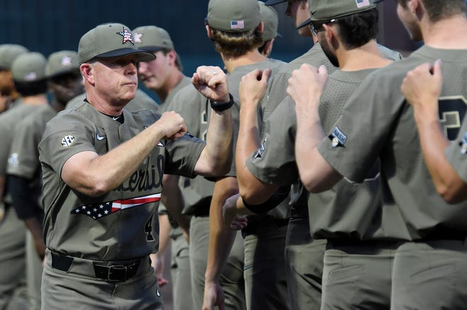 Vanderbilt head coach Tim Corbin bumps fists with his players before their game against Indiana State during the NCAA Division I Baseball Regionals on June 2, 2019, in Nashville.