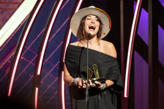 Lauren Daigle accepts her award as Female Artist of the Year during the 2019 K-Love Fan Awards at Grand Ole Opry House in Nashville, Tenn., Sunday, June 2, 2019.