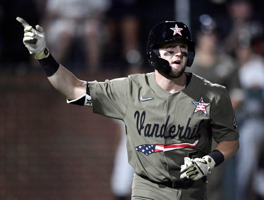 Vanderbilt designated hitter Philip Clarke (5) points to the sky after hitting a home run in the bottom of the fourth inning against Indiana State during the NCAA Division I Baseball Regionals at Hawkins Field Sunday, June 2, 2019, in Nashville, Tenn.