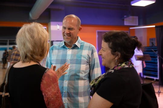 Pastor John Secrest talks with his church members Sharon Gronau, left, and Janis O'Malley, both from North Naples, Sunday, June 2, 2019, at the YMCA in North Naples.