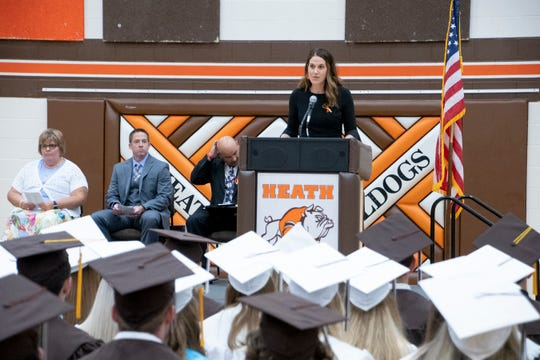 Heath High School principal Kat Fields addresses graduates during the 2019 ceremony. Superintendent Trevor Thomas said the district is planning a virtual ceremony on May 31.