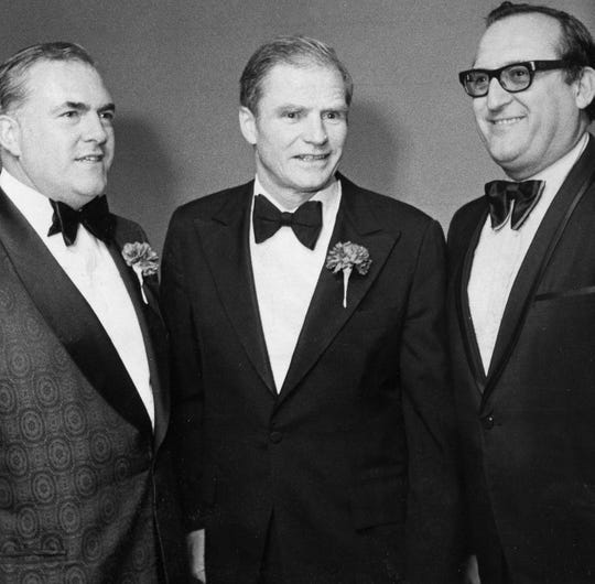 Gov. Brendan Byrne is flanked by freeholders Harry Randall, Jr. (left) and Jerry Calabrese at the Bergen Bar Assn. dinner held Friday night. MAY 4 1975