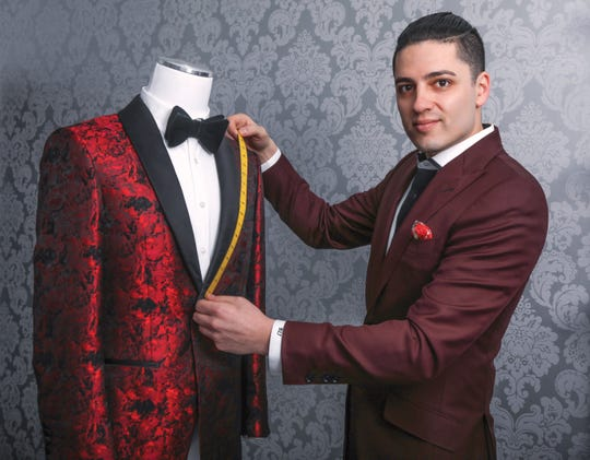 Bijan Zamanian owner of Dapper Concepts in his Westwood Ave. storefront where he gives some co\nsultaions on attire but usually makes house calls.