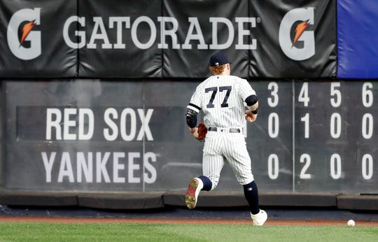 New York Yankees right fielder Clint Frazier (77) jogs after Boston Red Sox's Eduardo Nunez's RBI-single into deep right field after missing it on the first try during the seventh inning of a baseball game Sunday, June 2, 2019, in New York. Nunez reached third on the play. (AP Photo/Kathy Willens)