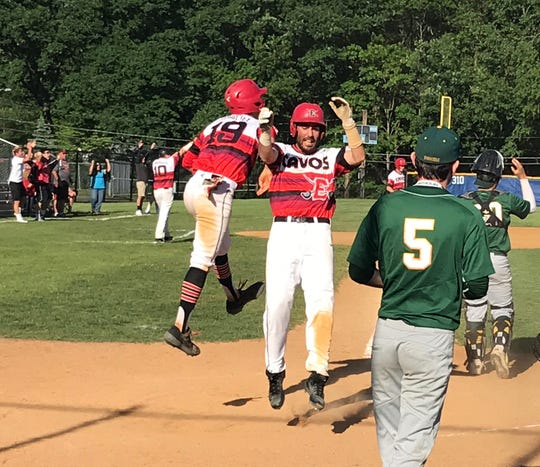 Seniors Peter Durocher (19) and Joe Carmosino celebrate after scoring the tying and go-ahead runs in the fifth inning of Emerson's Group 1 state-semifinal win over New Providence. Durocher later drove in the winning run to lift the Cavos to an eight-inning, 9-8 win on Monday, June 3, 2019.