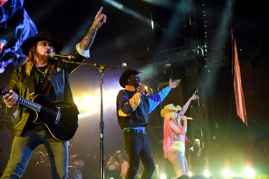 "(from left) Billy Ray Cyrus, Lil Nas X, and Cardi B perform ""Old Town Road"" during Hot 97's Summer Jam concert at MetLife Stadium on Sunday, June 2, 2019, in East Rutherford."